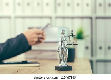 Attorney woman texting on mobile phone from her office desk, selective focus