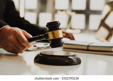 Attorneys or judges use the president's gavel to judge justice matters at law firms, legal concepts and legal services.