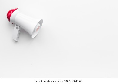 Attract attention concept. Megaphone on white background top view copy space