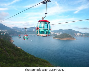 Attraction scenery high angle view of South China Sea, Island and surround hills from Hong Kong Ocean Park cable car which send people between the Waterfront and the Summit.