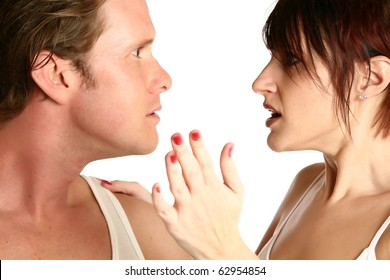 Attractive 35 year old couple fighting over white background. Motion blur on woman's hand.