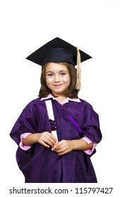 Attractive 5 year old girl in oversized large graduation cap and gown with diploma over white background