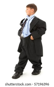 Attractive 6 year old american boy in over-sized baggy suit over white background.