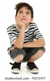 Attractive 8 year old boy making thinking expression over white.