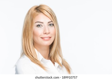 Attractive adult blonde lady smiling white background white shirt