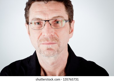attractive adult man with glasses and black shirt portrait