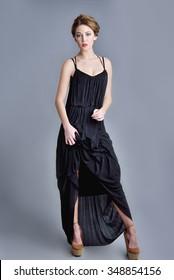 attractive adult model posing in black dress