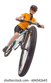 Attractive adult woman cyclist, riding a bike, looking at the camera. Isolated on white background. Studio shot from bottom to top. Close up of wheel.