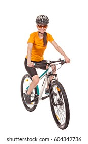 Attractive adult woman cyclist, riding a bike, looking at the camera and smiles. Isolated on white background, studio shot.