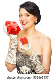 Attractive adult woman holding red present isolated on white background