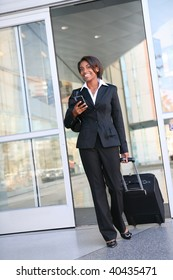 An attractive african american business woman traveling