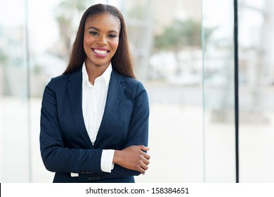 attractive african american corporate worker standing in office