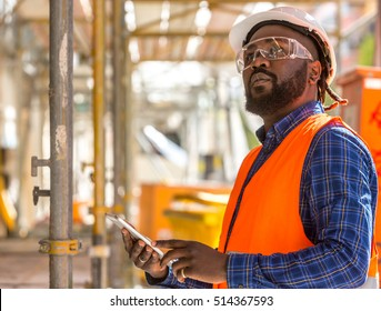 Attractive African american engineer at work on construction site