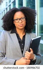 Attractive African American Professional Business Professional Wearing Black Glasses and Holding Folder