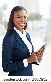 attractive african business executive working on tablet pc in office