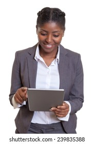 Attractive african businesswoman working with tablet computer
