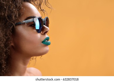 Attractive african girl with green lipstick