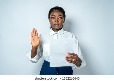 Attractive African woman holding papers with hands raised-concept on leadership, oath swearing or induction