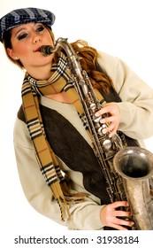 Attractive alternative dressed music performer, saxophone player.  Studio, white background