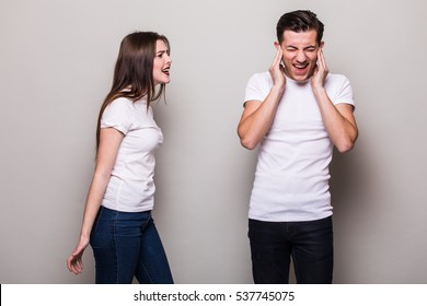 attractive angry couple fighting. Girl shouting at man