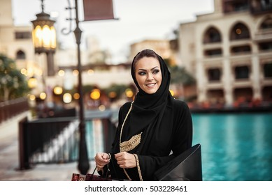 Attractive Arabian woman in traditional clothes.