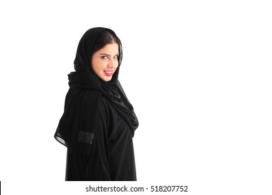 Attractive Arabian Woman Wearing Hijab standing over a white background