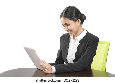 Attractive asian business women use tablet computer