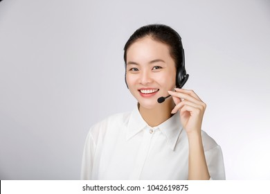 Attractive asian businesswoman with headset