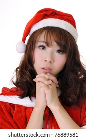 Attractive Asian Christmas girl, half length closeup portrait on white background.