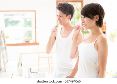 attractive asian couple dental care image