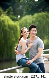 Attractive Asian Couple happy in park