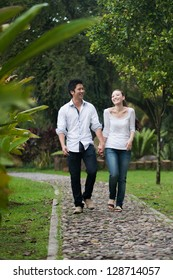 Attractive Asian Couple in Park walking happily