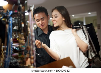 Attractive Asian Couple Shopping