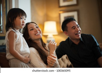 Attractive Asian Family in Lounge Area