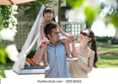 Attractive Asian Family Outdoor Lifestyle
