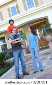 Attractive asian family outside their home having fun