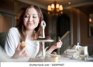 Attractive Asian Female Enjoying Desserts