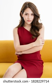 attractive asian female woman glamorous beauty skin concept wear red dress sit relax isolate white background