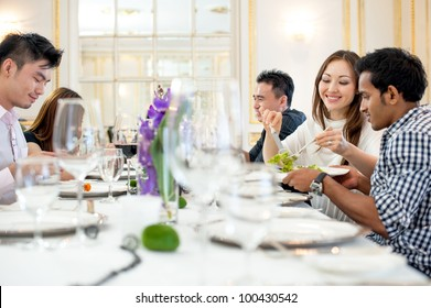 Attractive Asian Friends at a Restaurant