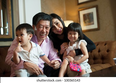 Attractive Asian Grand parents in Lounge