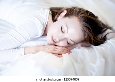 Attractive Asian Mixed Woman sleeping in bed peacefully