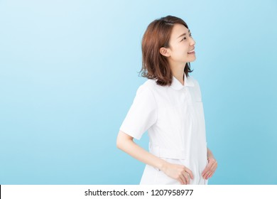 attractive asian nurse of the smile