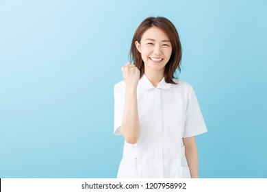 attractive asian nurse of the smile