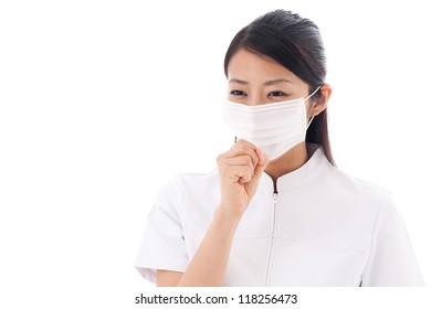 attractive asian nurse taking mask on white background