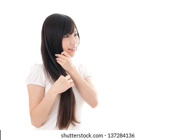 attractive asian woman with beautiful long hair on white background
