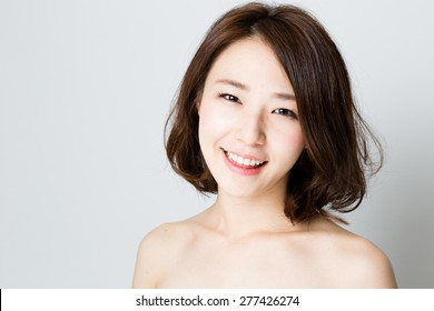 attractive asian woman beauty image on gray background