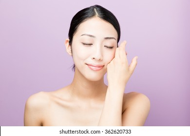 attractive asian woman beauty image isolated on purple background