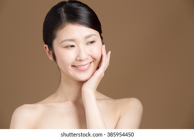 attractive asian woman beauty image isolated on brown background