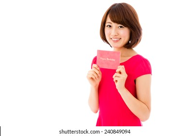 attractive asian woman with birthday card isolated on white background
