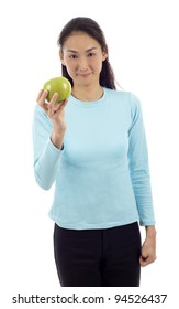Attractive Asian woman with blank blue shirt holding an apple isolated over white background